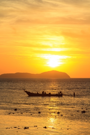 Beautiful sunrise in Rawai Phuket island Thailand with Long tailed boat Ruea Hang Yao photo