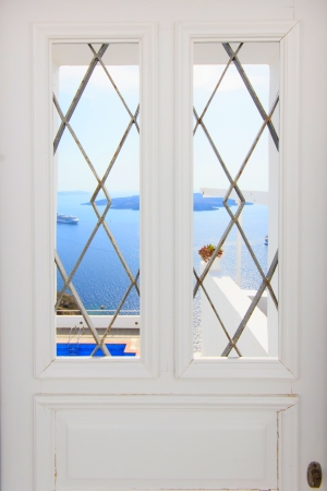 Santorini balconny with view at the Aegean sea photo