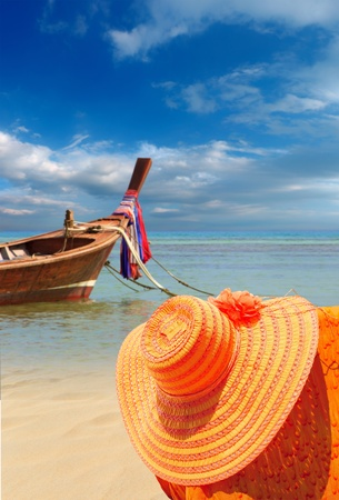 long tailed boat: Straw hat and Long tailed boat in Phuket Thailand