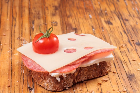 slice bread with salami cheese and tomatoes photo