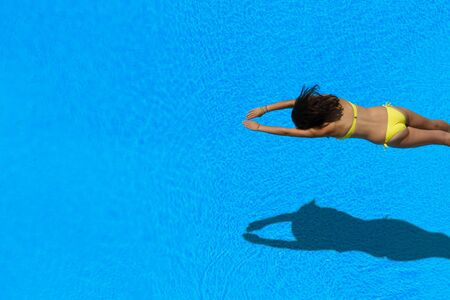 hot girl legs: Top view of a girl diving in the swimming pool