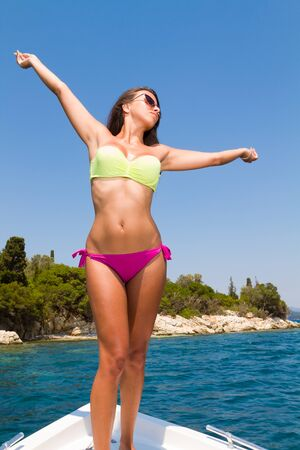 beautiful girl relaxing on speed boat