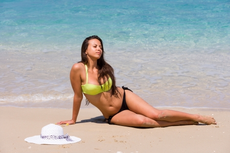 Beautiful young woman in bikini on the beach photo