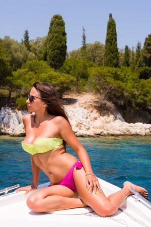 beautiful girl relaxing on speed boat Reklamní fotografie