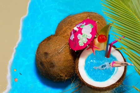 Travel Concept woman in Coconut cocktail swimming pool photo