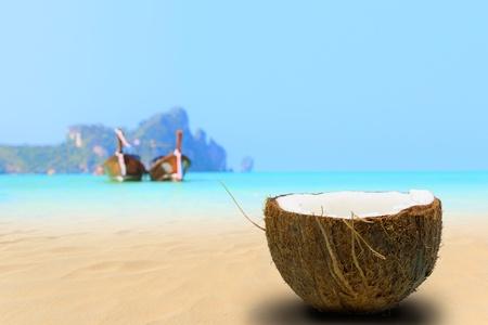 caribbean drink: Coconut on the beach in Phi Phi island Thailand