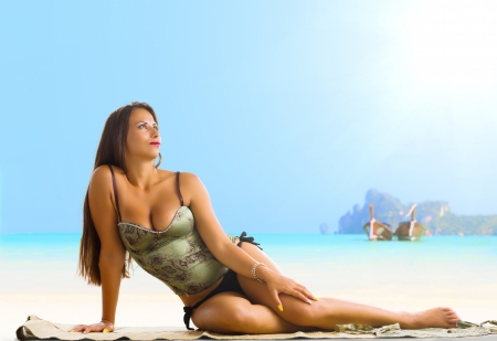 Phi: Young woman reaxing on the beach at exotic resort Stock Photo