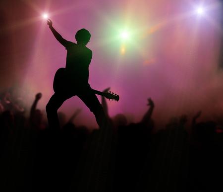 croud: guitarist at rock concert Stock Photo