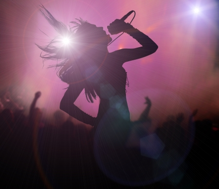 Female singer silhouette at rock concert photo