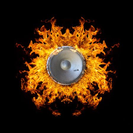 Loudspeaker on Fire Isolated on Black Background photo