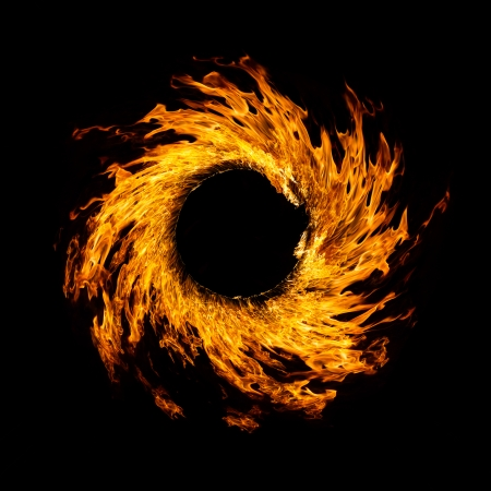 Blazing flames circle over black background
