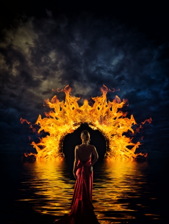 Woman at hell's door dramatic background Banque d'images