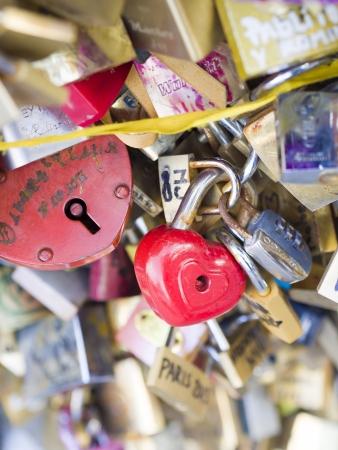 PARIS - December 6: Love Padlocks at Pont de lArchevêché on December 6, 2013, in Paris. The thousands of locks of loving couples symbolize love forever.