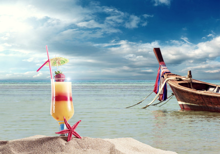 bacardi: Fresh Cocktail on the beach in Thailand with Long tailed boat on background  Stock Photo