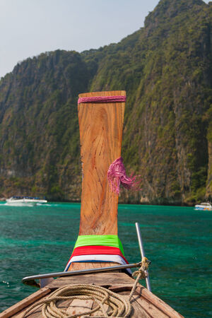 Traditional longtail boat in the famous Maya bay of Phi-phi Leh island, Thailand photo