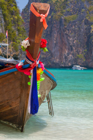 longtail: Traditional longtail boat in the famous Maya bay of Phi-phi Leh island, Thailand