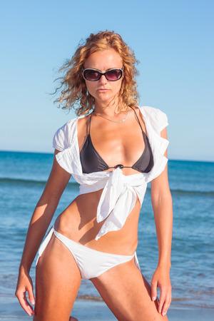 Woman in white shirt on the tropical beach photo