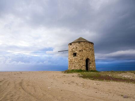 Old windmill ai Gyra beach, Lefkada Greece photo