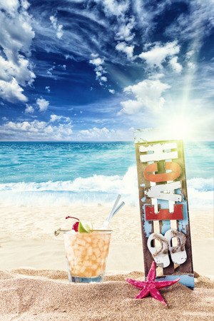 Fresh tropical cocktail on beautiful sunny beach photo