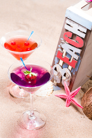 Fresh tropical cocktail on the beach - molecular mixology photo