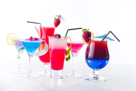 Fresh tropical layered cocktails over white background photo