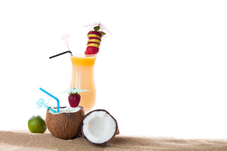 Fresh tropical cocktail on the sand photo