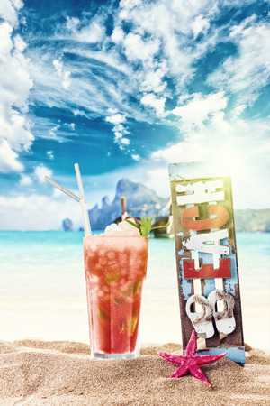 Fresh tropical lime cocktail on beautiful sunny beach photo