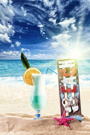 Fresh tropical blue lagoon cocktail on beautiful sunny beach photo