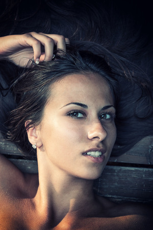 18's: Beautiful Woman portrait over wood background Stock Photo