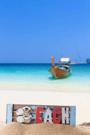 Longtail boat on the sea tropical beach. Andaman Sea, Thailand photo