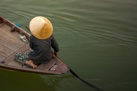A woman rowing boat in Cai Rang Vietnam. Stock Photo