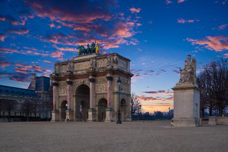 Arc de Triomphe at the Place du Carrousel in Paris at sunrise Stock Photo