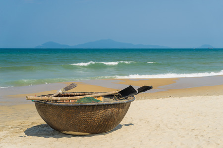Traditional fishing boat on the beach of Hoi An