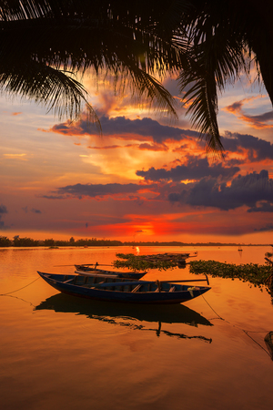 Vinh Cura Dai river in Hoi An Vietnam at sunset