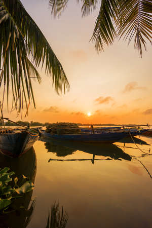 Vinh Cura Dai river in Hoi An Vietnam at sunset