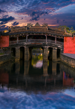 Old Japanese bridge in the night lights. Historical landmark of the city Hoi An, Vietnam
