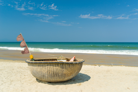 Traditional fishing boat on the beach of Hoi An Da Nang Vietnam Stock Photo