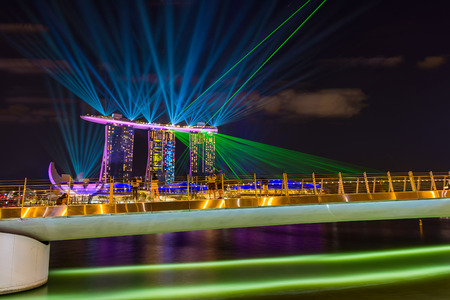 SINGAPORE CITY, SINGAPORE - APRIL 17, 2018: Spectra Light and Water Show Marina Bay Sand Casino Hotel Downtown Singapore on APRIL 17, 2018 Editorial