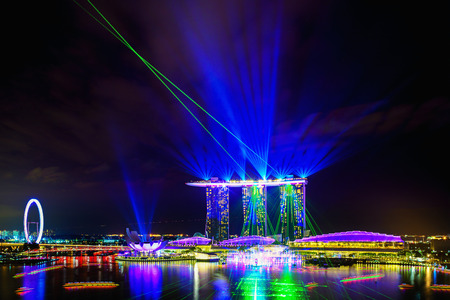 SINGAPORE CITY, SINGAPORE - APRIL 22, 2018: Spectra Light and Water Show Marina Bay Sand Casino Hotel Downtown Singapore on APRIL 22, 2018