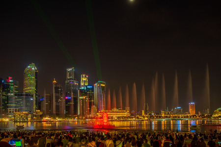SINGAPORE CITY, SINGAPORE - APRIL 21, 2018: Spectra Light and Water Show Marina Bay Sand Casino Hotel Downtown Singapore on APRIL 21, 2018