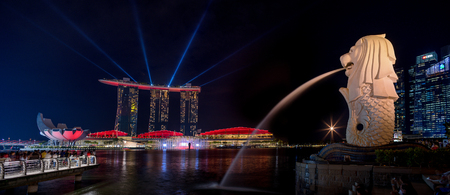 SINGAPORE CITY, SINGAPORE - APRIL 16, 2018: Spectra Light and Water Show Marina Bay Sand Casino Hotel Downtown Singapore on APRIL 16, 2018