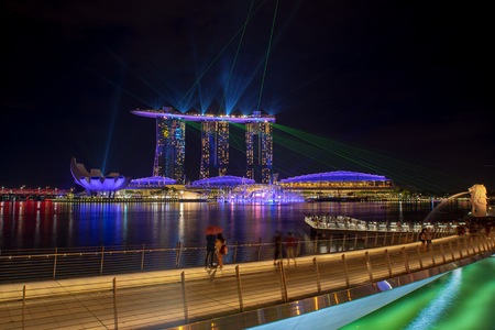 SINGAPORE CITY, SINGAPORE - APRIL 15, 2018: Spectra Light and Water Show Marina Bay Sand Casino Hotel Downtown Singapore on APRIL 15, 2018 Editorial