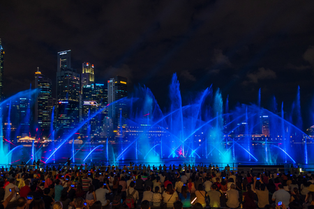 SINGAPORE CITY, SINGAPORE - APRIL 19, 2018: Spectra Light and Water Show Marina Bay Sand Casino Hotel Downtown Singapore on APRIL 19, 2018