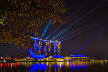 SINGAPORE CITY, SINGAPORE - APRIL 14, 2018: Spectra Light and Water Show Marina Bay Sand Casino Hotel Downtown Singapore on APRIL 14, 2018