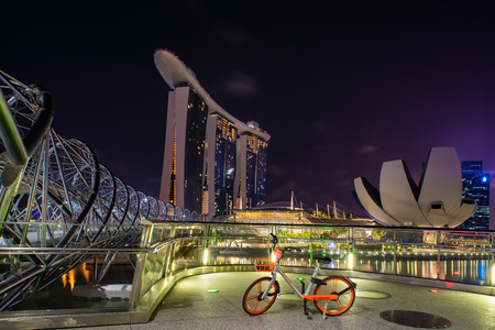 Singapore, Singapore - April 13, 2018: View of the Marina Bay in Singapore at  night with the iconic landmarks of The Helix Bridge. Editorial