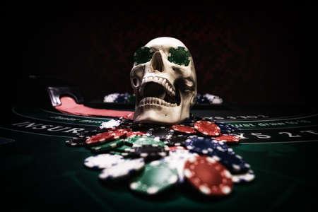 Human skull at Black Jack table
