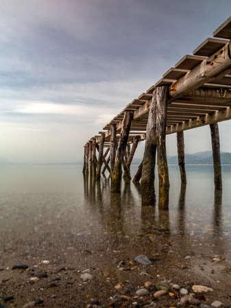 Wooden pontoon on Evia island Greece 版權商用圖片