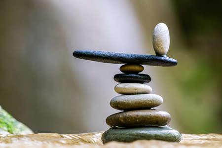 Balanced Zen stones pebbles at the waterfalls Foto de archivo