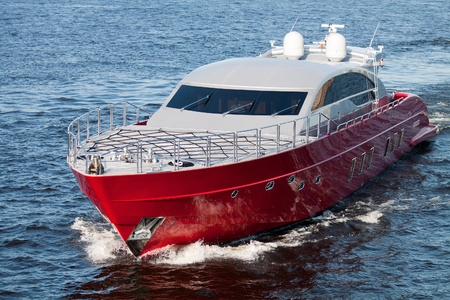 retiring: Luxury red speed boat with water splashes