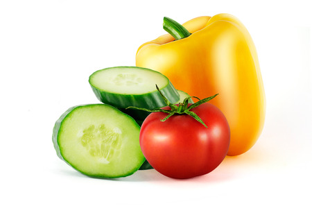 truck crops: Tomato, pepper and cucumber isolated on white background